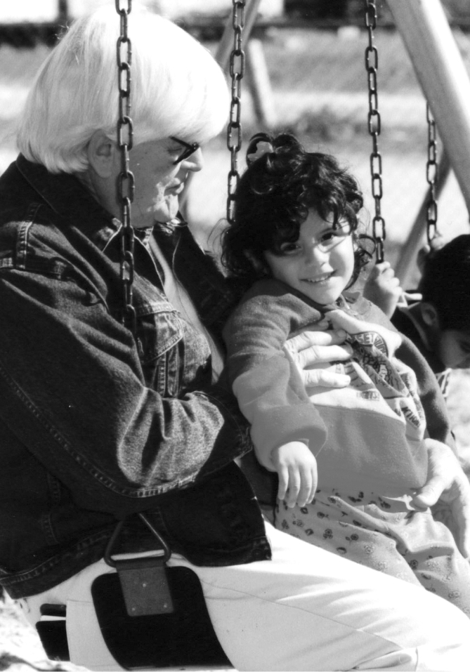 Photo of Wendell Rollason in a swing with a kid